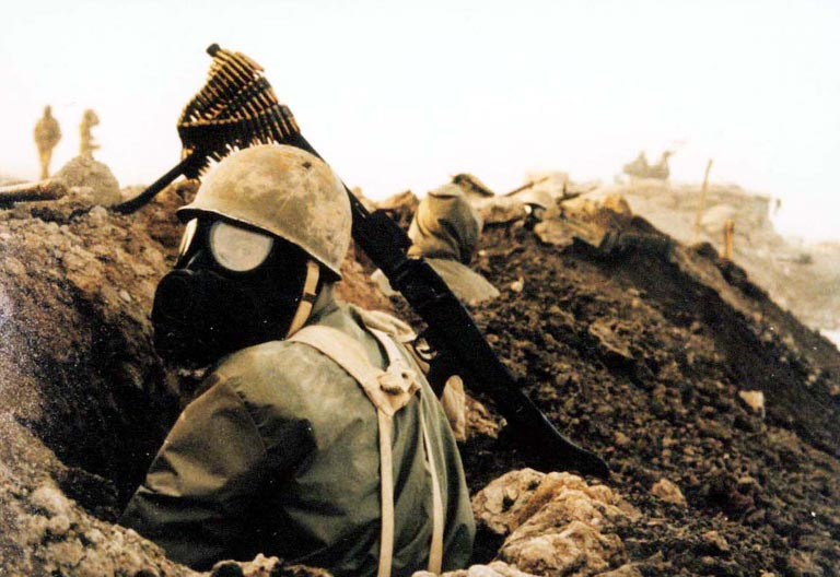 An Iranian soldier wearing a gas mask during the Iran-Iraq War.