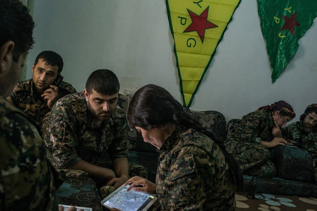 Kurdish fighters and US launch airstrikes in Syria
