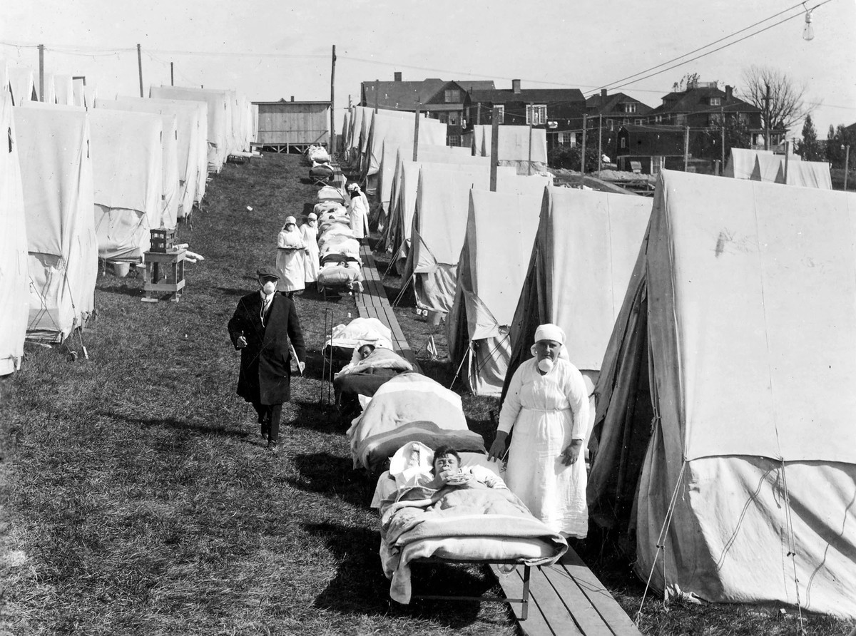 Influenza patients getting sunlight at the Camp Brooks emergency open-air hospital in Boston