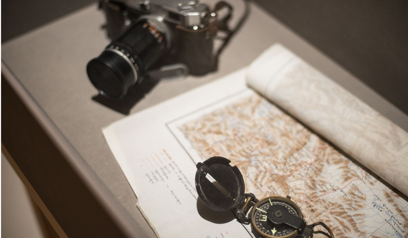 A CIA-issued camera, goggles and maps from Lhamo Tsering's collection. Photo: Raisa Galofre