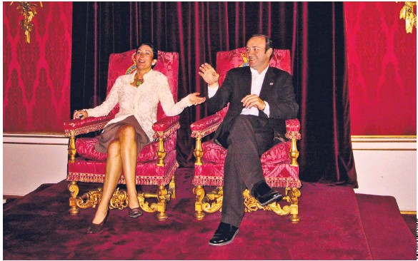 Ghislaine Maxwell on Buckingham Palace throne